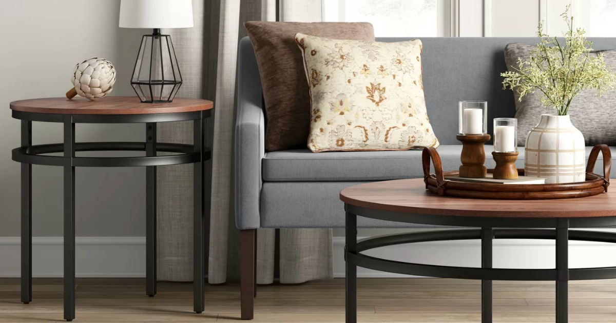 Large gray settee bench in living room setting near coffee table and end table