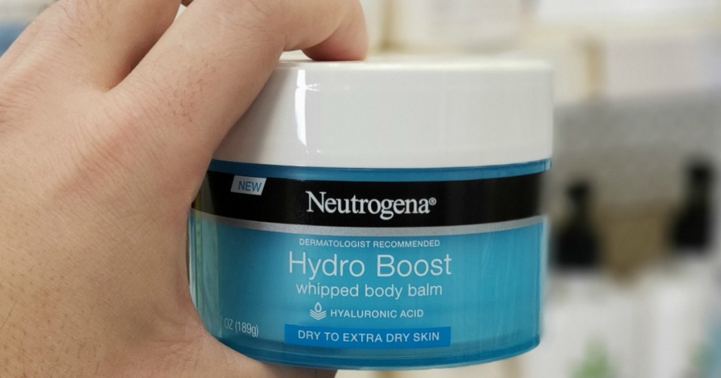 hand holding jar of Neutrogena Hydro Boost Body Balm