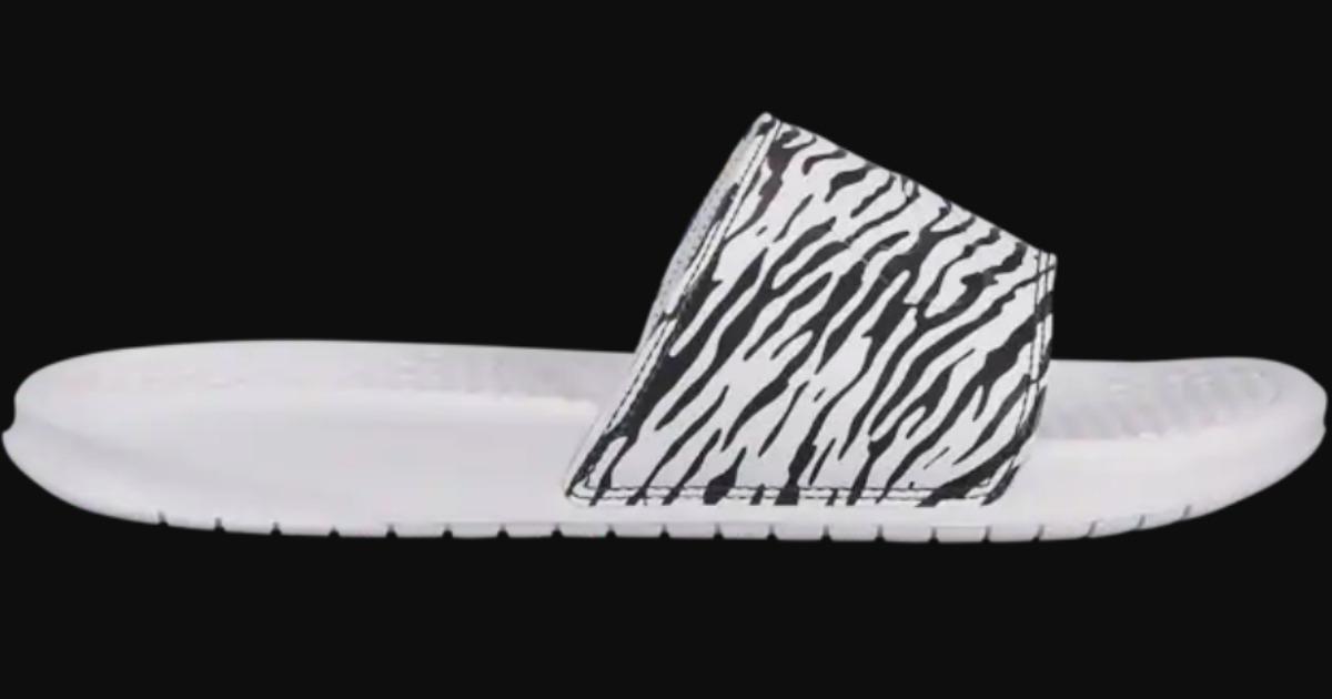 Nike animal print women's slides with a black backround