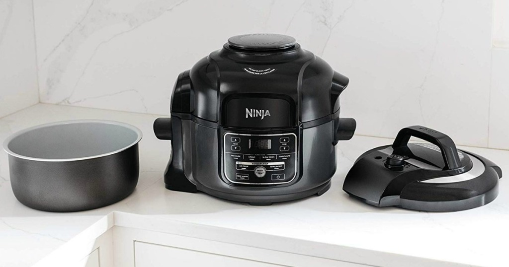 Pressure cooker on counter with lid and insert
