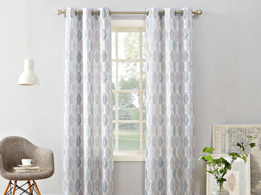 Curtain Panel on window in livingroom with chair and plant