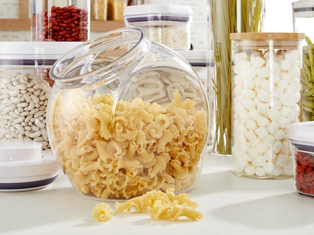 Large storage container with dry pasta inside near other coordinating storage containers