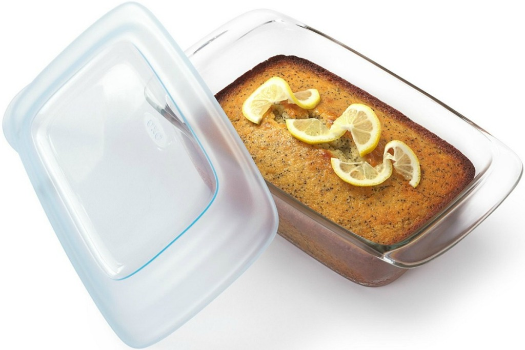 Loaf of Lemon Poppyseed bread in a glass loaf pan with coordinating lid