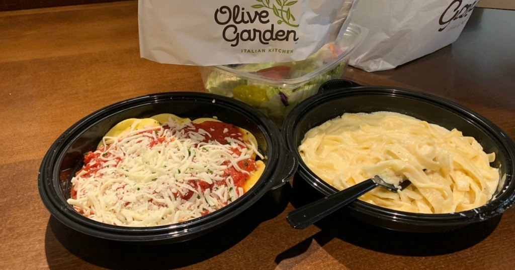 two olive garden buy one get one pasta meals on a table