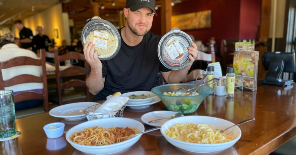 Man with to go trays at Olive Garden