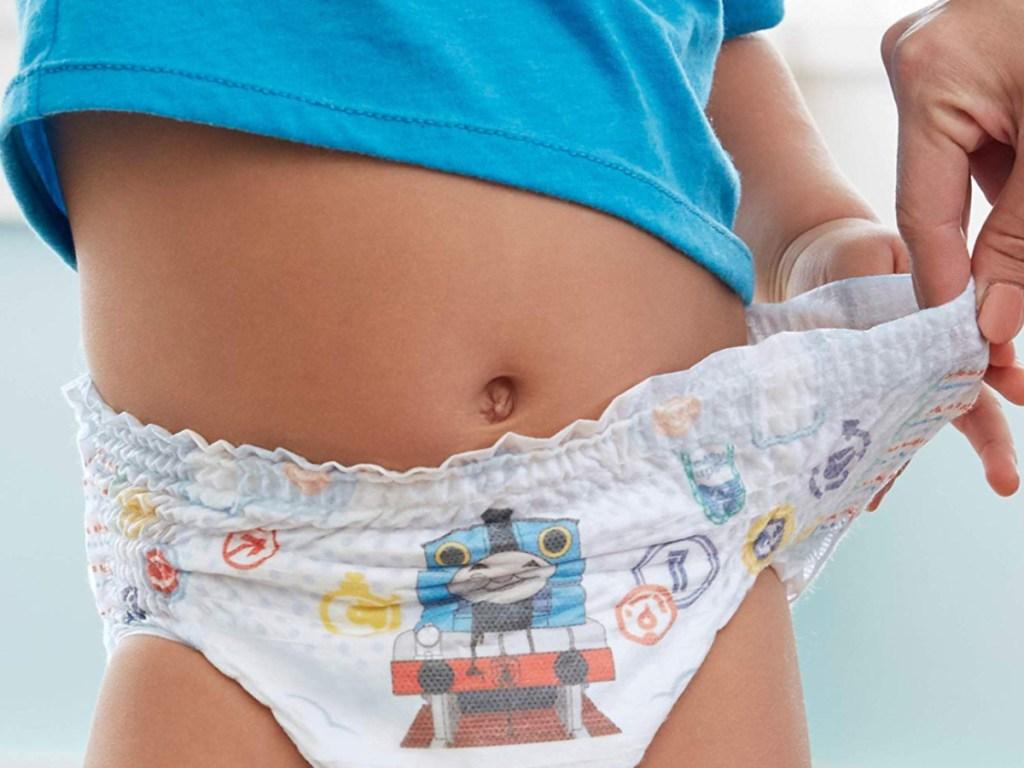 Woman holding boy's diaper