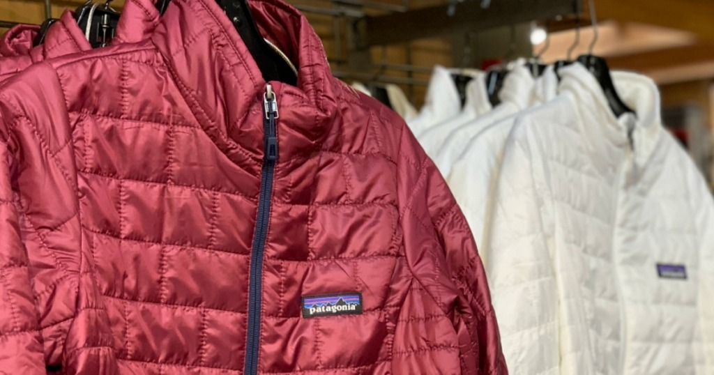 Patagonia jackets on hangers at REI