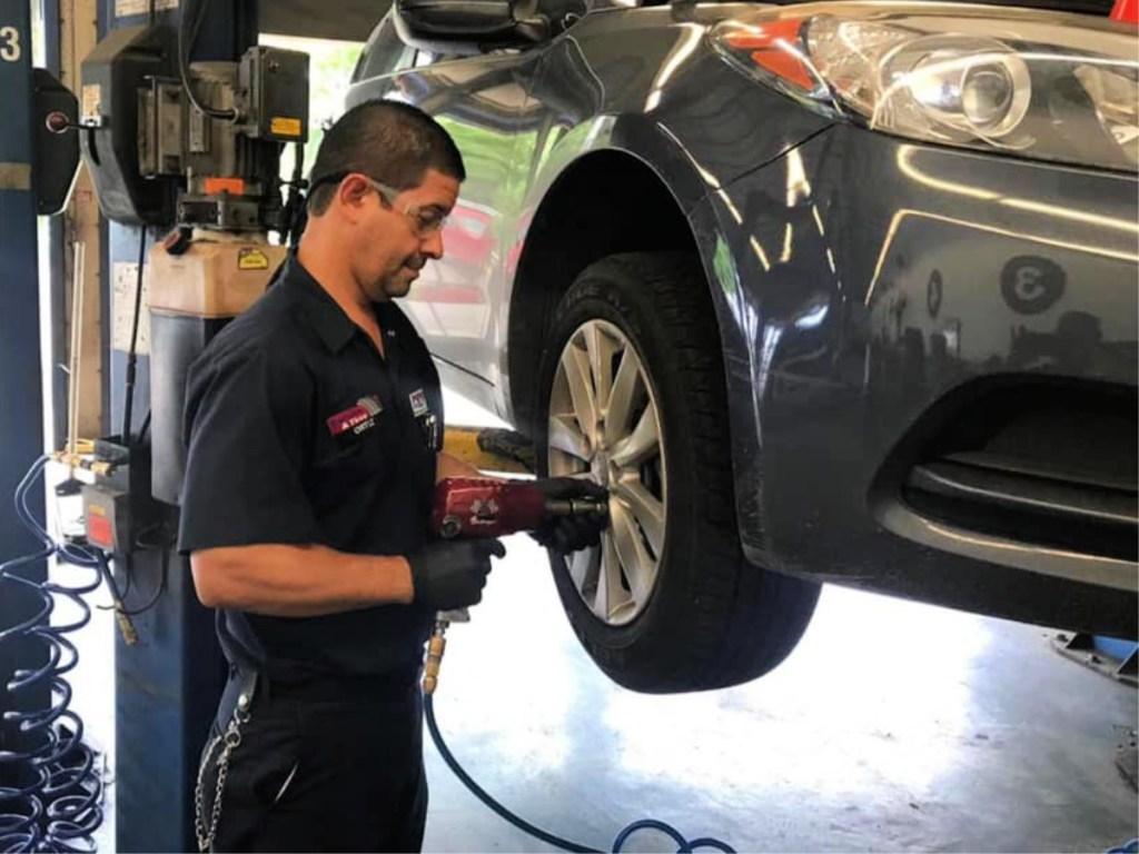 Pep Boys technician working on tires