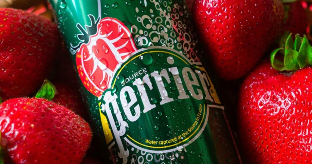Perrier strawberry beverage can surrounded by strawberries