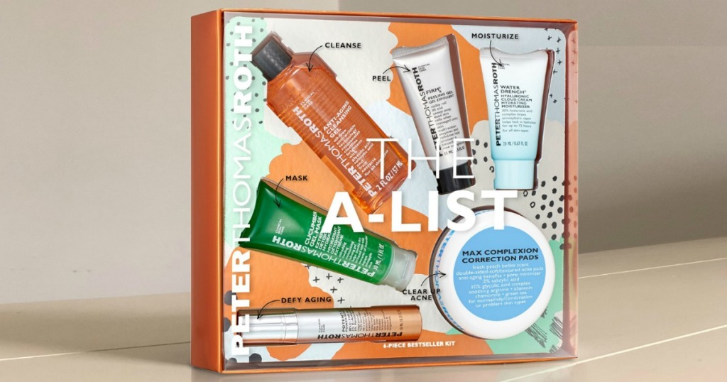 Beauty gift set in package on display on beige surface