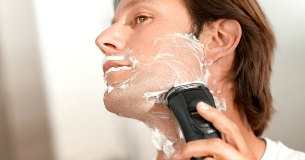 man shaving with an electric razor