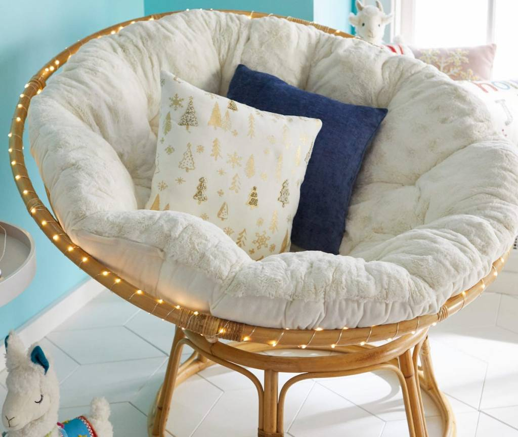 papasan chair with pillows in it