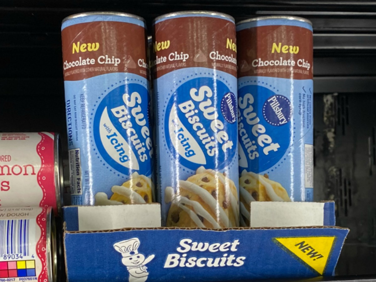 Pillsbury brand sweet rolls in tubes in box on shelf in refrigerated section