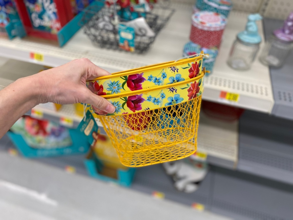 hand holding yellow and flower basket