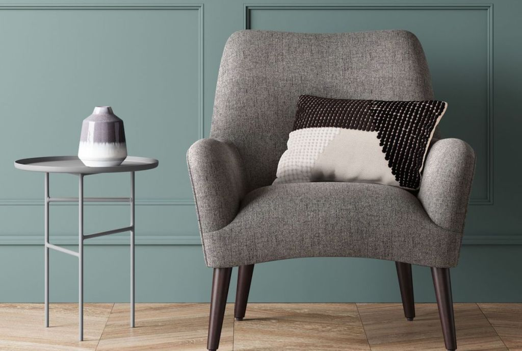 accent table next to a grey chair
