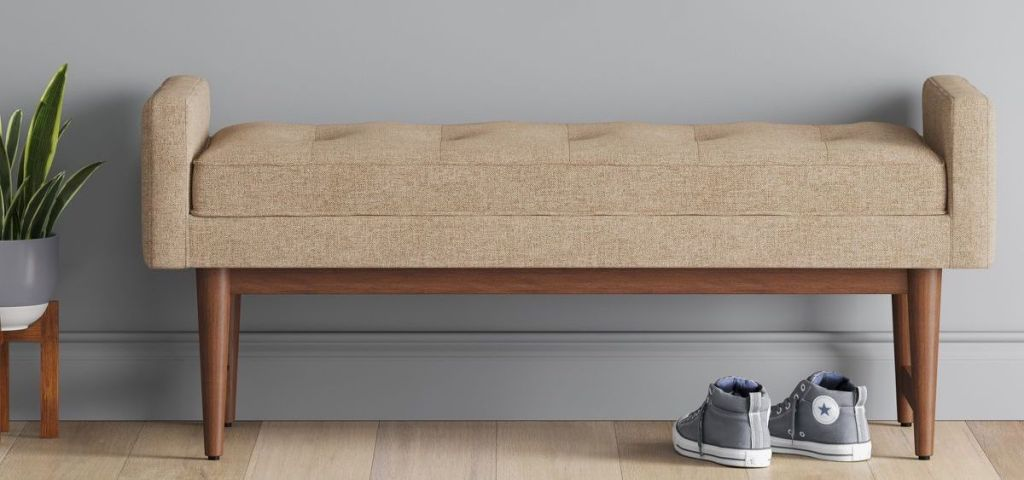 tan bench with shoes underneath