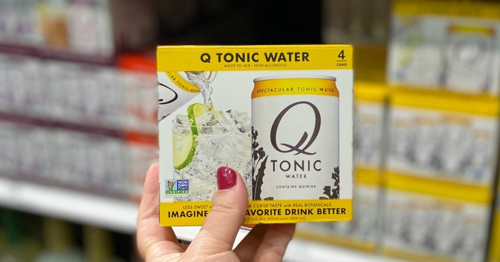Woman's hand holding Q Drink Tonic Water