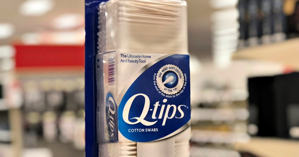 Q-Tips Cotton Swabs in hand at store