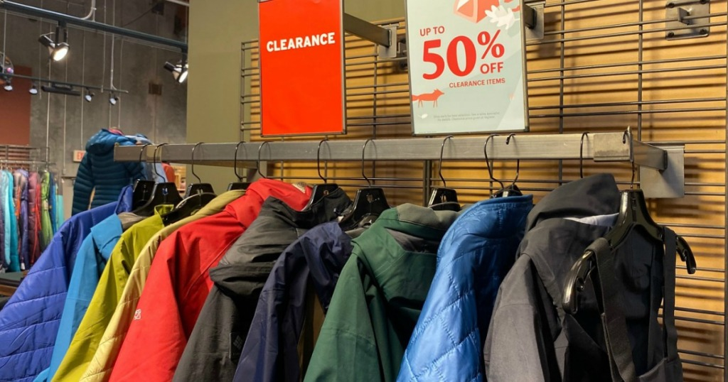 Rack of clearance winter jackets in-store at REI