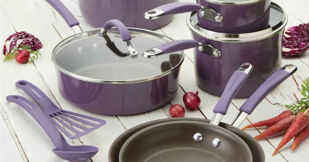 large collection of purple cookware with coordinating glass lids