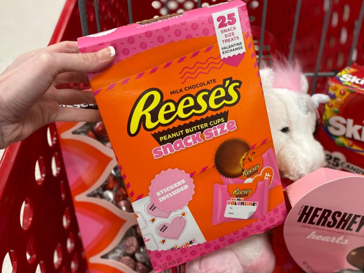 hand holding box of Valentine's Day Reese's snack size candy