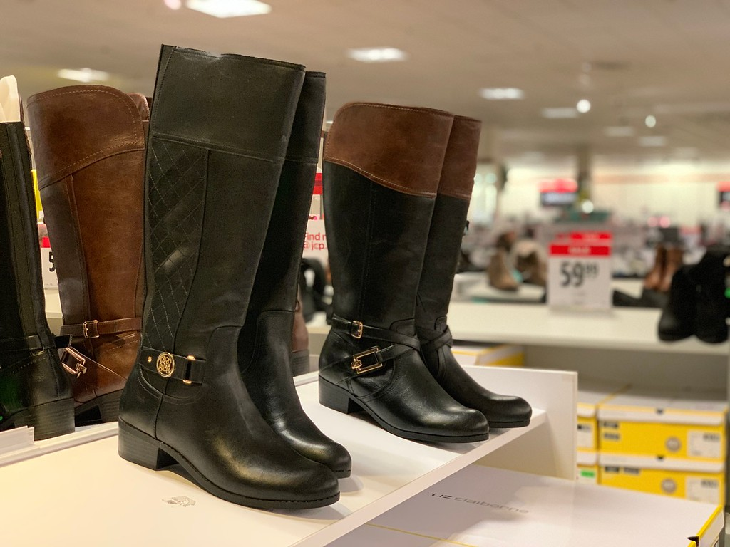 riding boots on a shelf