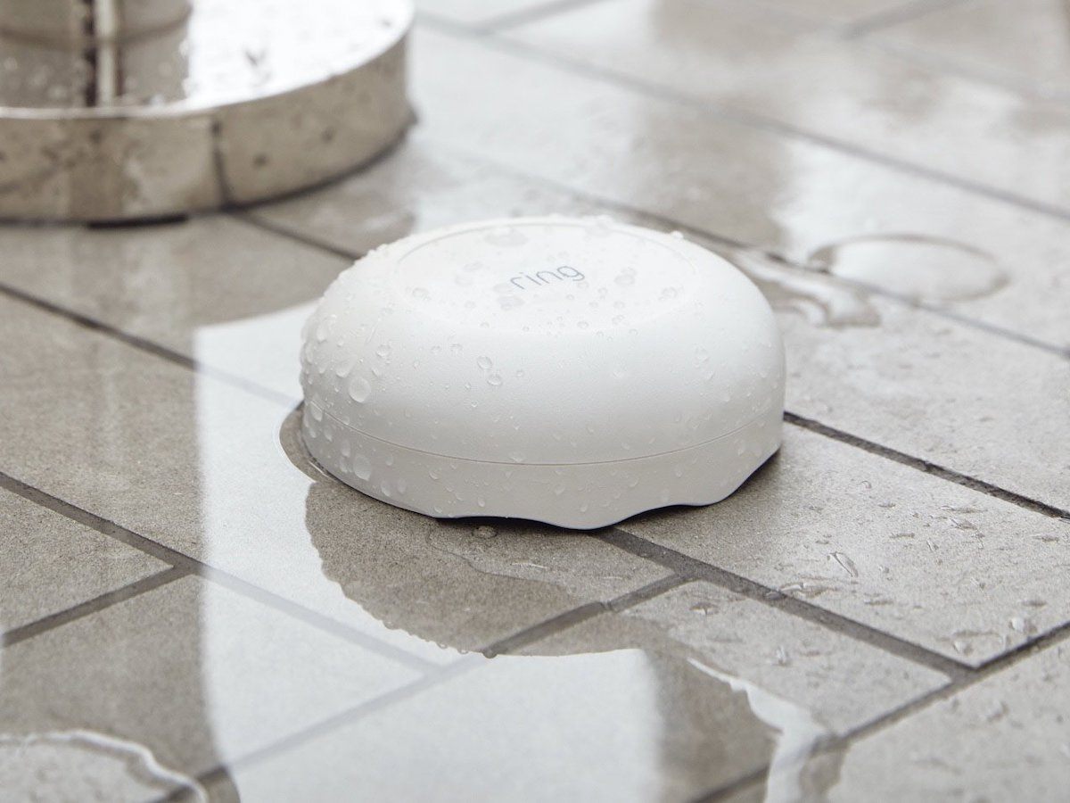 Ring Flood and Freeze Monitor on tile floor with water on it