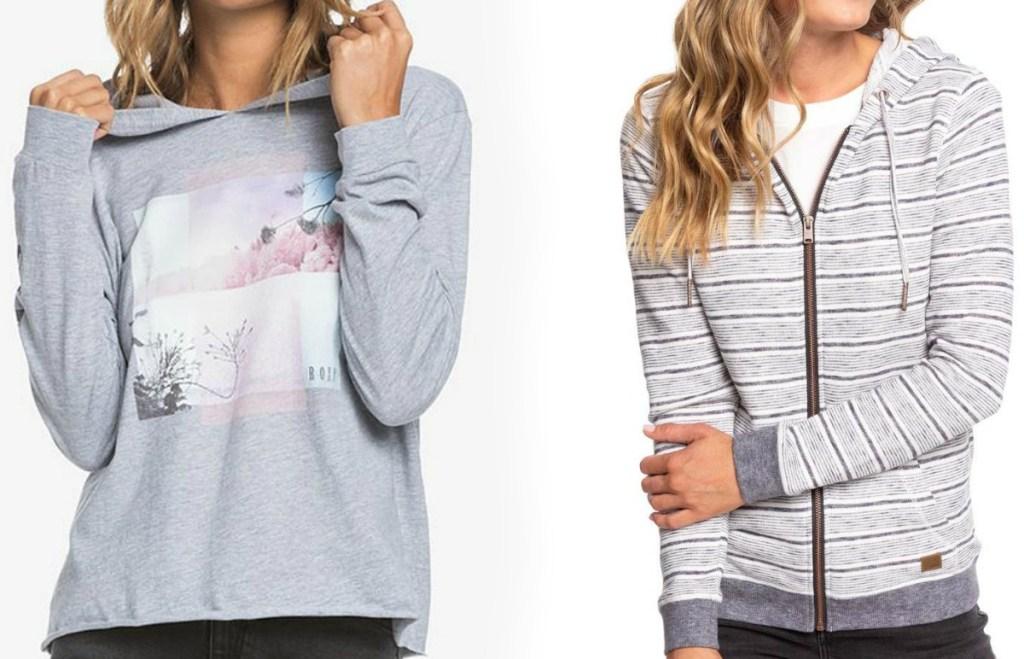Two women wearing gray hoodies