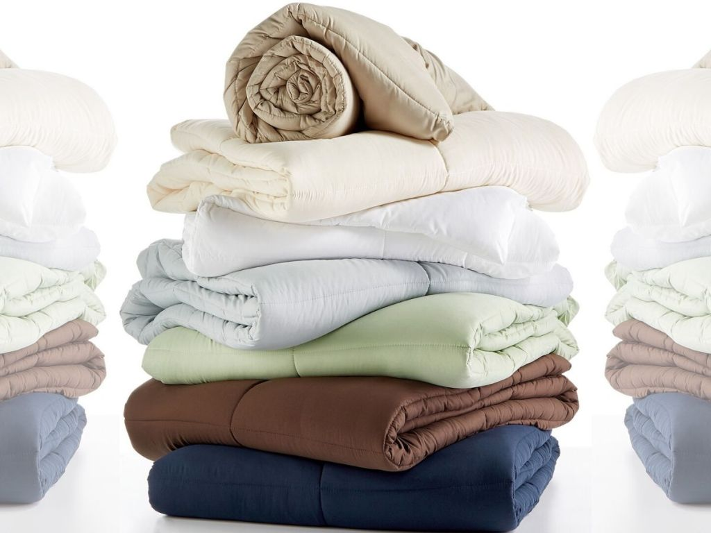 folded stack of down alternative comforters