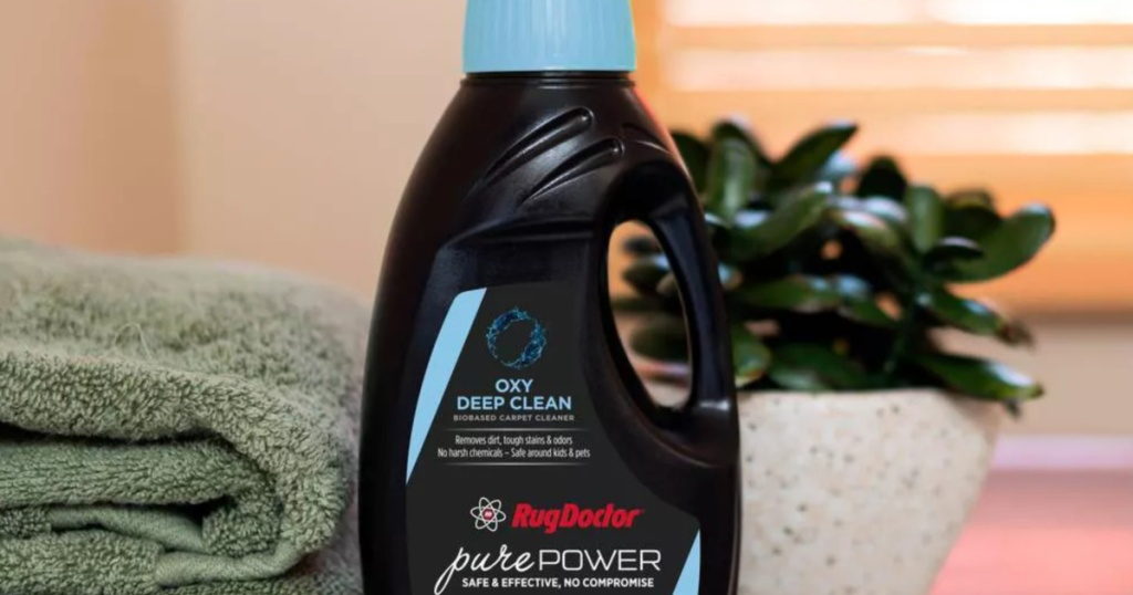 Rug cleaner and towels and plant
