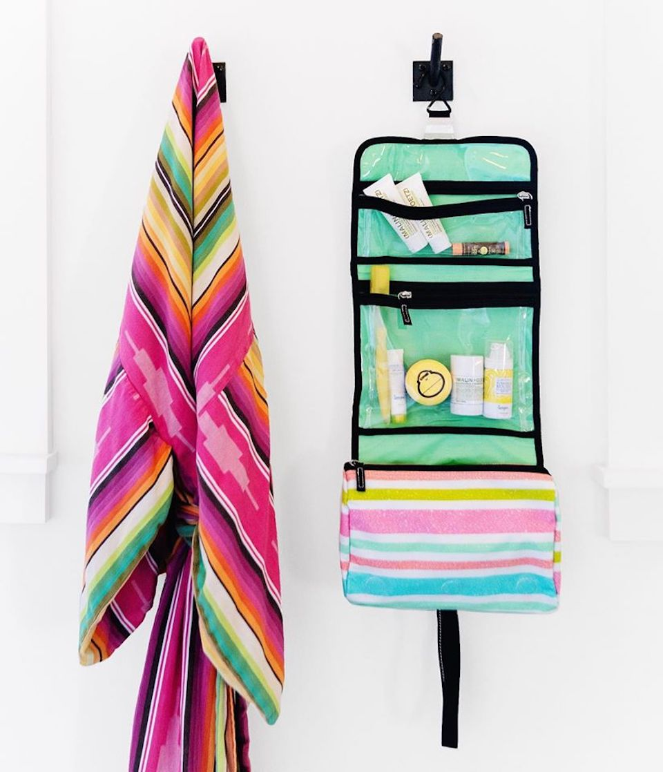 towel hanging next to a cosmetic case