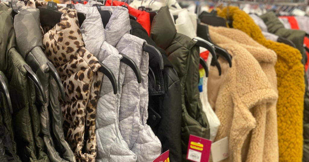 SO puffer vests on rack in store