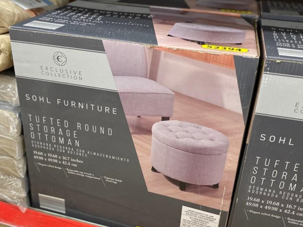round ottoman in box on store shelf