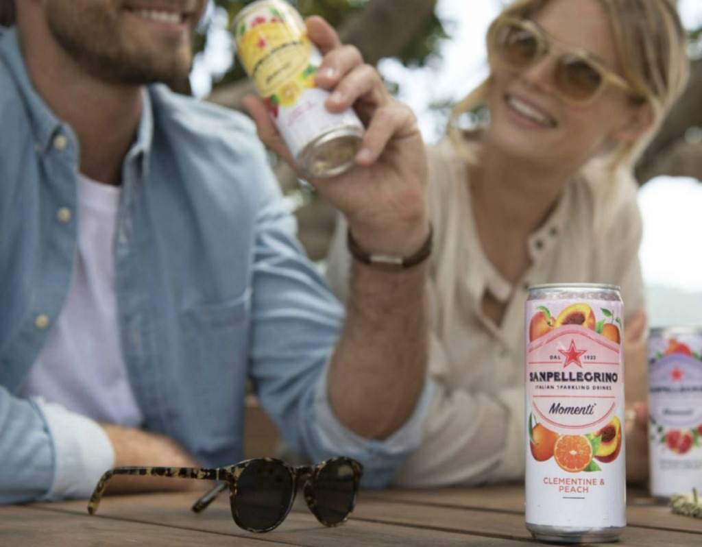 man and woman drinking Sanpellegrino beverages