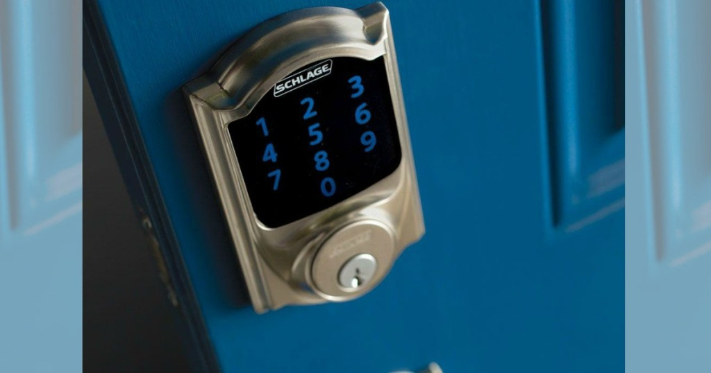 smart door lock with a key pad on a blue door