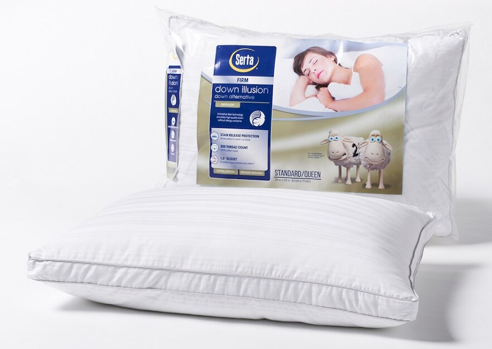 Serta down pillow laying next to pillow in package