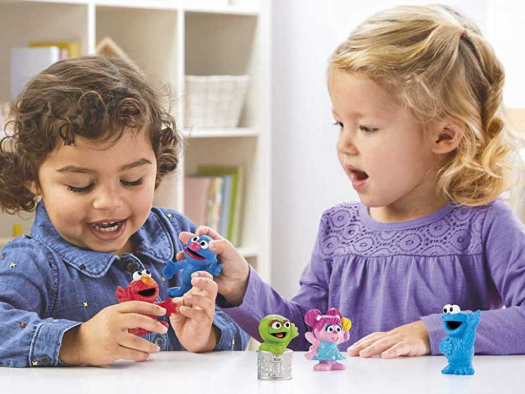 two girls playing with Sesame Street Playskool Collector Pack 5 Figures