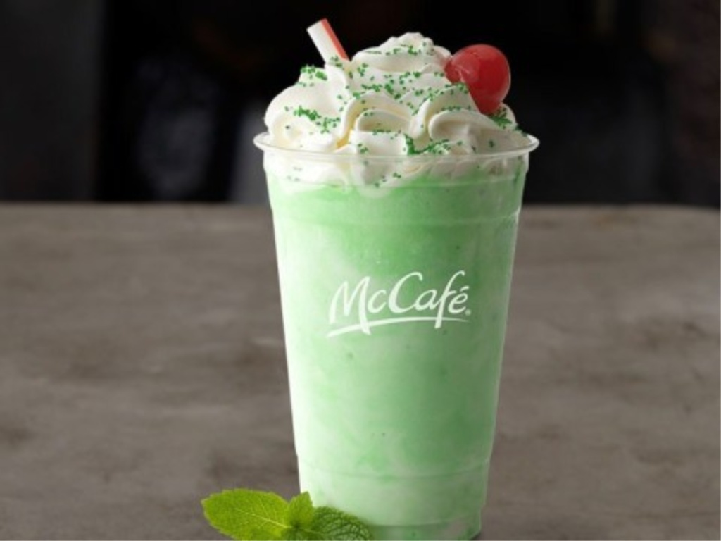 Shamrock Shake with whipped cream, green sprinkles, and cherry