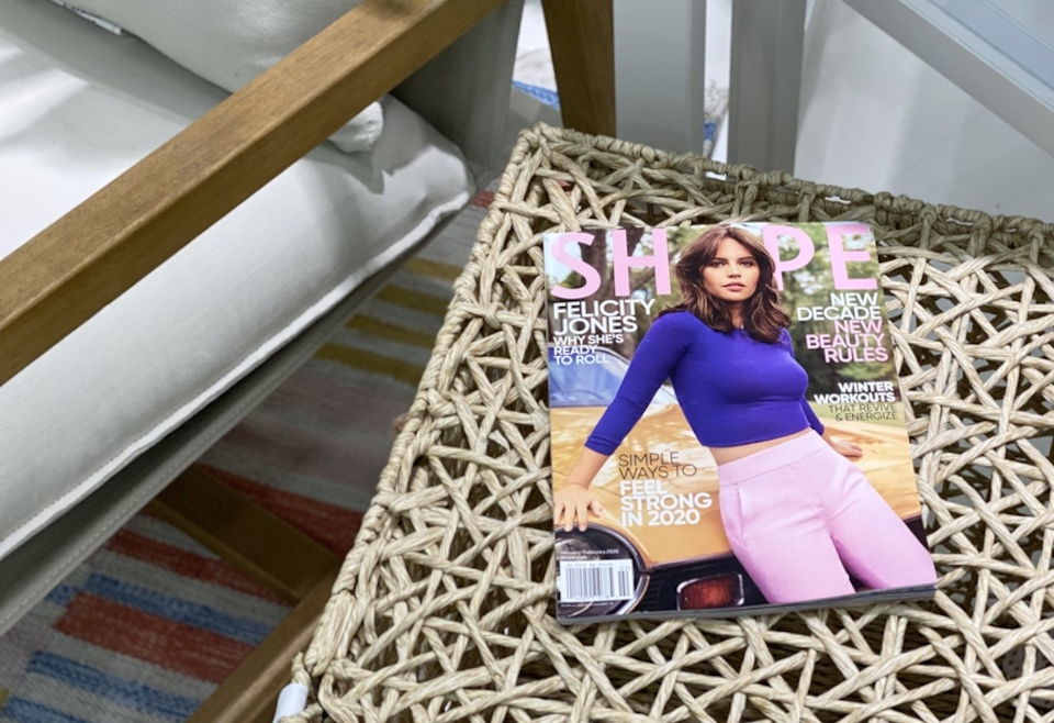 shape magazine sitting on a table by a chair