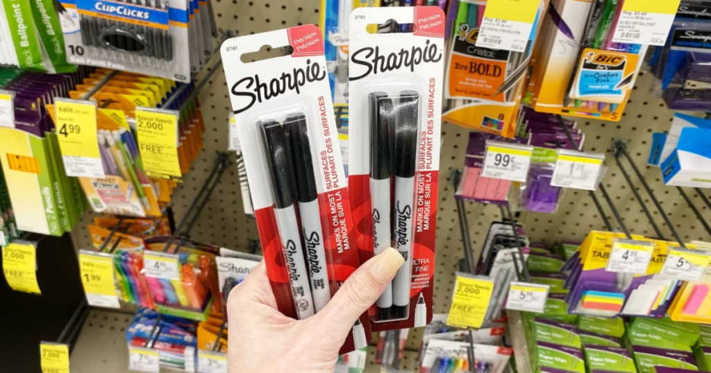 Hand holding Sharpie Fine Point Markers at Walgreens