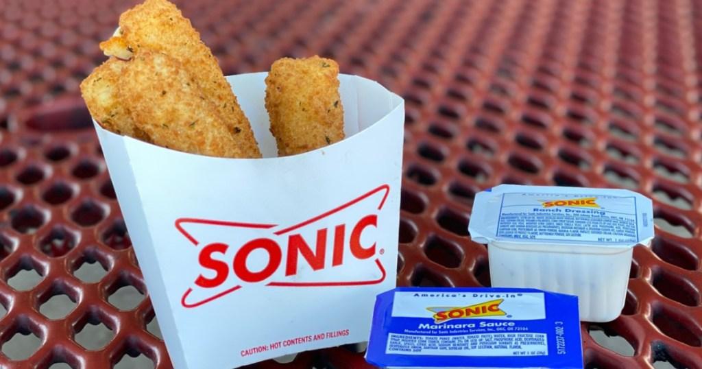 Sonic Mozzarella Sticks sitting on picnic table