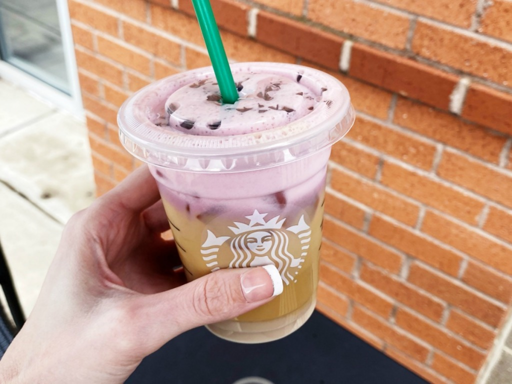 Woman holding Starbucks Secret Chocolate Strawberry Cold Brew outside