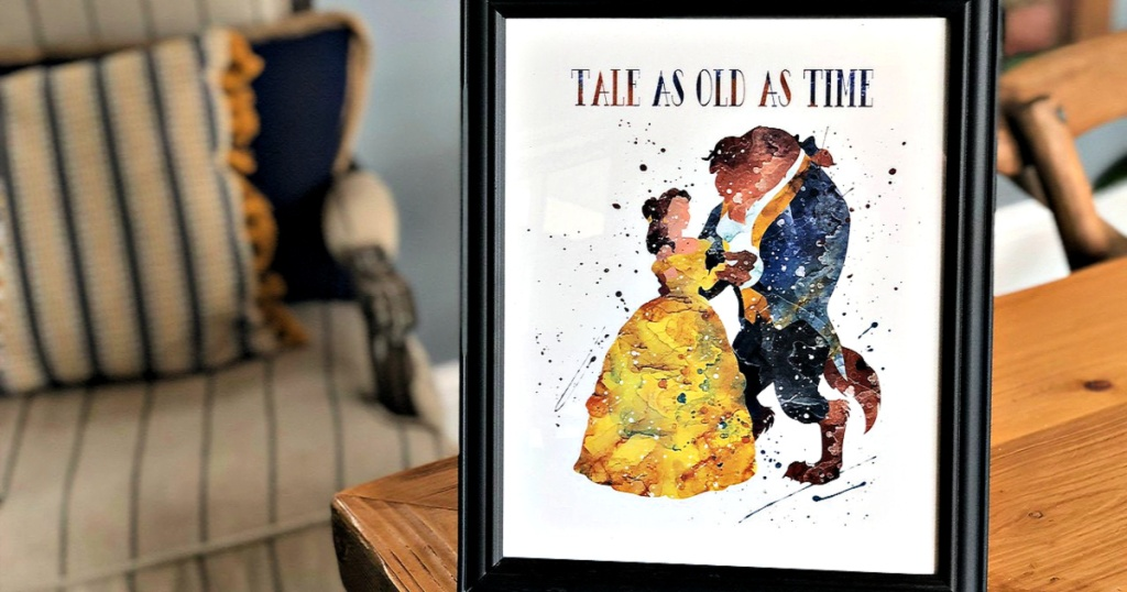 Tale as Old as Time Disney Print in frame on table