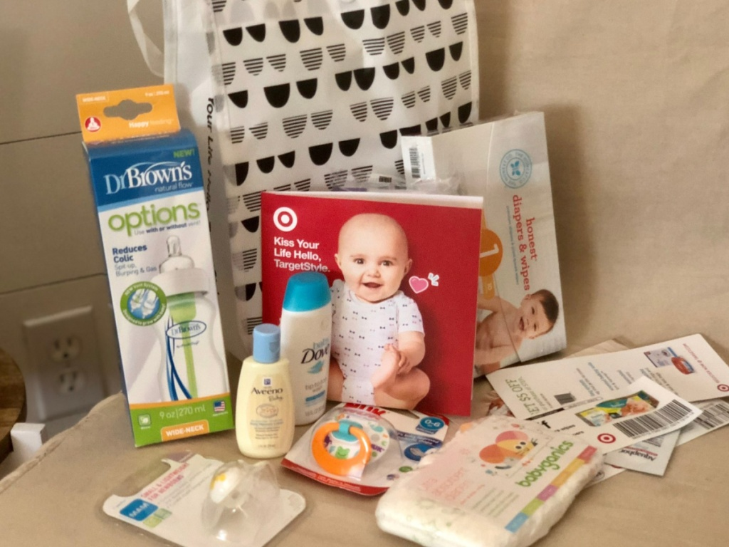 Target Baby Registry tote bag sitting on a chair with baby freebies