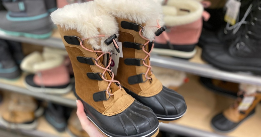 hand holding little girl winter boots at Target