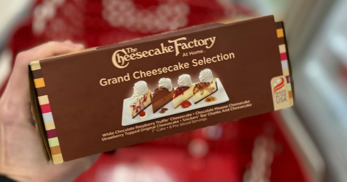 womanholding The Cheesecake Factory Grand Cheesecake Selection