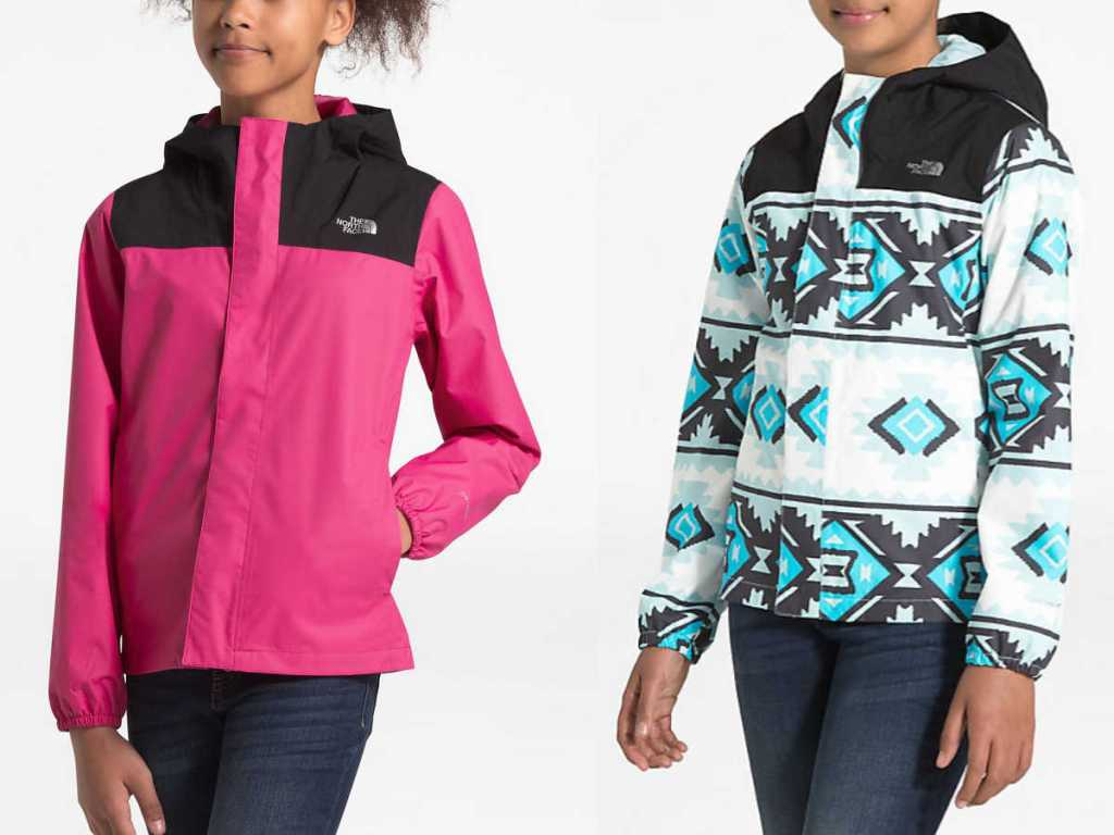 girls wearing black and pink and blue, white, and black The North Face Girls Resolve Reflective Waterproof Jacket