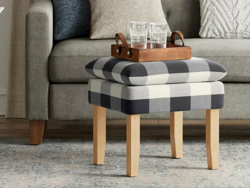 Blue and White plaid footstool with drinkware set on top