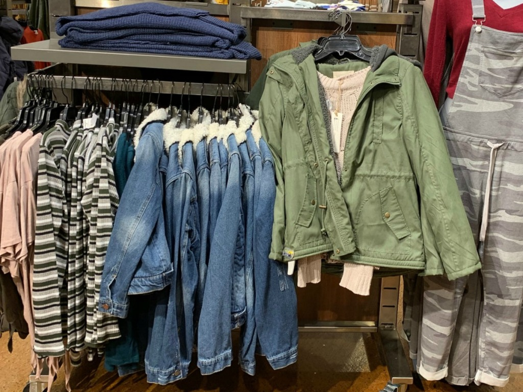 In-store display of girls jackets in various styles and colors at Tillys