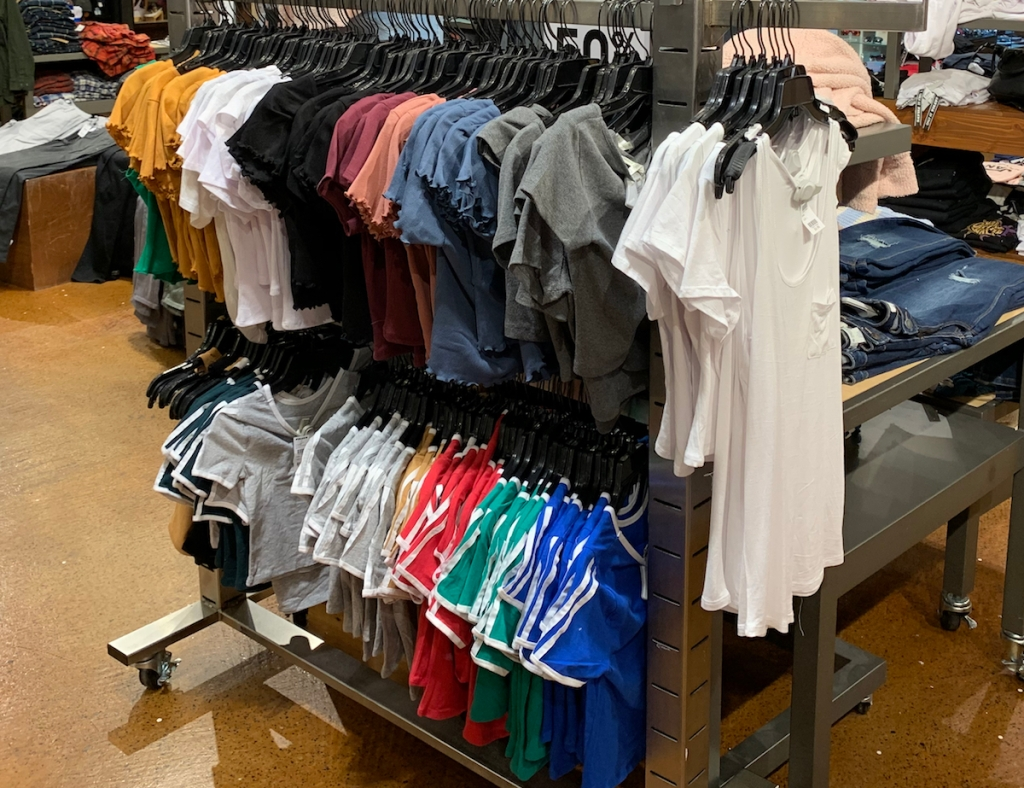 girls tees on hangers on a display at a store